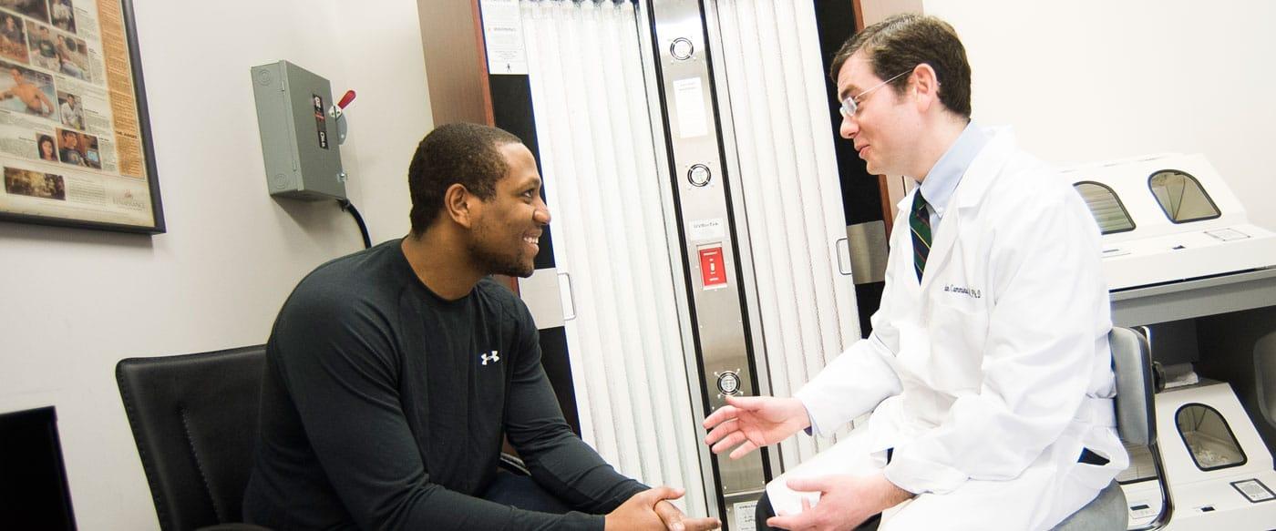 Dr. Jordan Cummins MD with a Patient
