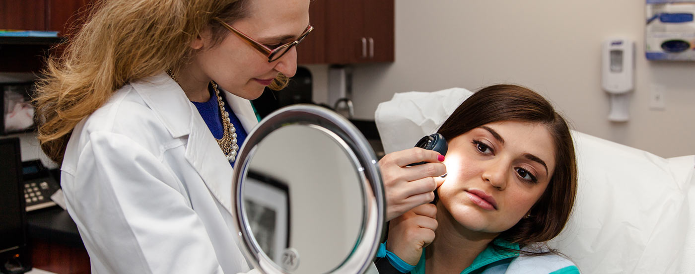 Dr. Bis doing cosmetic consultation